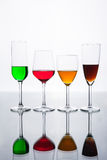 Set of several wine glass and color water Royalty Free Stock Image