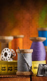 Set of sewing items on wooden table Stock Photo