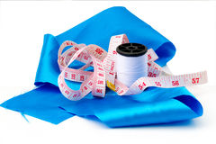 Set sewing: thread, cloth, tape measure. Stock Photography