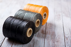 Set of sewing threads for shoes on a wooden background Royalty Free Stock Image
