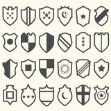 Set of shield icons with symbols Royalty Free Stock Photo