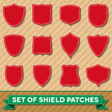 Set of shield shaped stitched patches Stock Photography