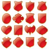 Set of shields. Isolated raster version of vector set of red shields bordered with gold Royalty Free Stock Image