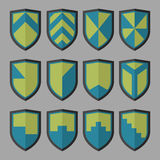Set of shields blue and green. 12 blank of retro shields Royalty Free Stock Image