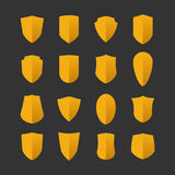 Set of shields in flat design style Stock Images