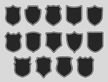 Set of shields over grey background Stock Photos