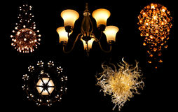 Set of Shining chandeliers over black background Stock Photography