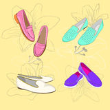 Set of  shoes. On floral background Royalty Free Stock Photos