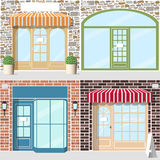 Set of shop facade. Set of four detailed shop entrance. Facade f stone and brick. Striped awnings, flowers in pots, lanterns Stock Photo
