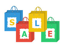 Set of shopping bags with letters of sale word on them. stock illustration