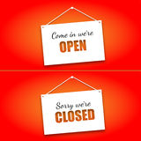 Set of signs on the doors Opened and Closed on a bright red background. Hanging signs, paper card Stock Photos