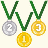 Set of signs medal. First second and third place, golden silver and bronze medals with laurels wreath and green ribbon, flat design medal icon Royalty Free Stock Photo