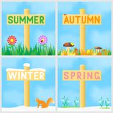 A set of signs with the names of the seasons. Stock Image