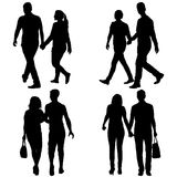 Set Silhouette man and woman walking hand in hand Stock Image