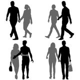 Set Silhouette man and woman walking hand in hand Stock Photos