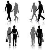 Set Silhouette man and woman walking hand in hand Stock Photography