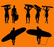 Set of silhouette surfers Stock Photos