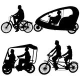 Set silhouette of two athletes on tandem bicycle on white background.  Royalty Free Stock Images