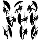 Set silhouettes of alpinists (climbers). Set of vector silhouettes alpinists (climbers) with ice ax Stock Images