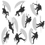 Set silhouettes of alpinists. Stock Image