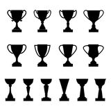 Set of silhouettes of award cups and trophies. Vector illustration Stock Photos