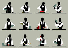 Set of silhouettes of a bartender prepares cocktails Stock vecto Royalty Free Stock Photos