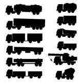 Set of silhouettes the cargo trucks. Royalty Free Stock Images