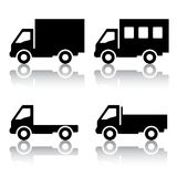 Set of silhouettes the cargo trucks. Royalty Free Stock Photos