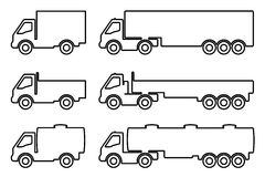 Set of silhouettes the cargo trucks. Royalty Free Stock Image