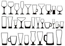 Set of silhouettes of different glasses for drinks. Vector. Vector set of black and white silhouettes of glass glasses for alcoholic and nonalcoholic, hot and Stock Image