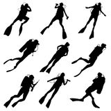 Set silhouettes of divers. Set of vector silhouettes scuba diving in different poses Royalty Free Stock Image