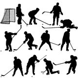 Set of silhouettes of hockey player. Isolated on Stock Photography
