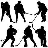 Set of silhouettes hockey player. Isolated on white. Vector illustrations Royalty Free Stock Images