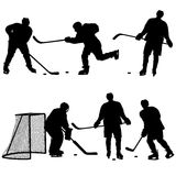 Set of silhouettes hockey player. Isolated on white. Vector illustrations Stock Photography