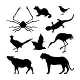 Set of silhouettes of Japanese animals. Black tiger, crane and pheasant on a white background Royalty Free Stock Images