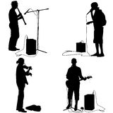 Set  silhouettes  musicians playing musical instruments. Vector Stock Photos