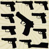 A set of silhouettes of pistols Royalty Free Stock Images