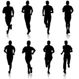 Set of silhouettes. Runners on sprint, man. Set of silhouettes Runners on sprint, man Royalty Free Stock Photos