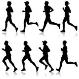 Set of silhouettes. Runners on sprint, man and woman.  Stock Photo