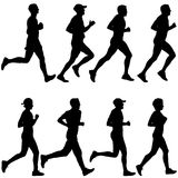 Set of silhouettes. Runners on sprint, man and woman.  Stock Images