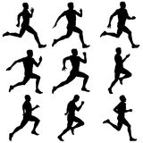 Set of silhouettes. Runners on sprint, men. Set of silhouettes. Runners on sprint men Royalty Free Stock Images