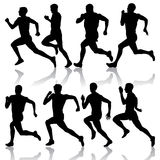 Set of silhouettes. Runners on sprint, men. vector Royalty Free Stock Photo