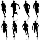 Set of silhouettes. Runners on sprint, men. vector Royalty Free Stock Image