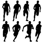 Set of silhouettes. Runners on sprint, men. vector Stock Photos