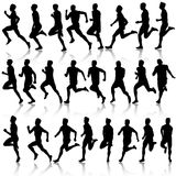 Set of silhouettes. Runners on sprint, men. vector Stock Photography
