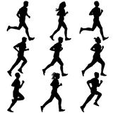 Set of silhouettes. Runners on sprint, men. Stock Images