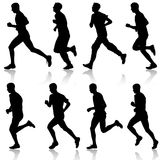 Set of silhouettes. Runners on sprint, men. vector. Illustration Stock Photo