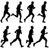 Set of silhouettes. Runners on sprint, men. vector. Illustration Stock Images