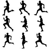 Set of silhouettes. Runners on sprint, men. Vector illustration Stock Image