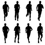 Set of silhouettes. Runners on sprint, men. Vector illustration Stock Photography